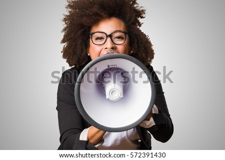 business black woman shouting on the megaphone - Shutterstock ID 572391430