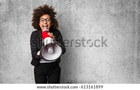 business black woman shouting on the megaphone