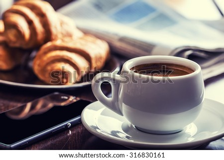 Business break with  Cup of coffee croissants and mobile phone. #316830161