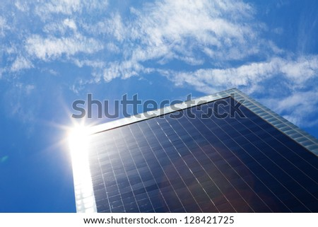 business building and blue sky with sunbeams