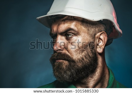 Business, building, industry, technology - builder concept. Business, building concept - builder in hard hat. Close up engineers working. Side view portrait. Copy space for yours advertise.