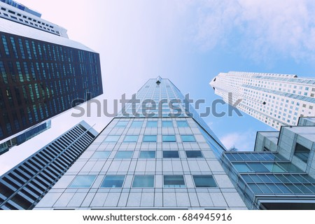 Business buildings looking up view with blue sky. Cityscape downtown and skyscraper modern architecture buildings. Business background. #684945916