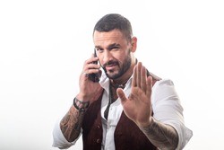 Business call. Man well groomed rich fashionable macho. Clothes and accessories. Fashion macho. Mobile conversation. Bearded guy white background. Mafia boss. Guy handsome mafia boss hold smartphone.