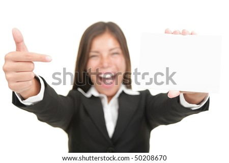 Business card. Excited woman pointing at business card / blank empty sign. Isolated on white background, focus on hand and card.