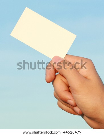 business card in a man's hand