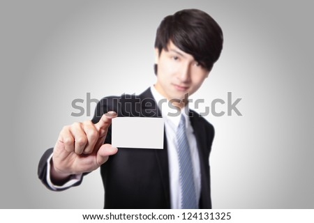 business card in business man hand with smile face ( focus on paper ) isolated on gray background, asian male model