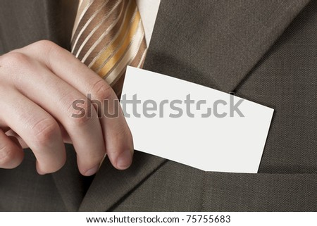 Business card in his hand