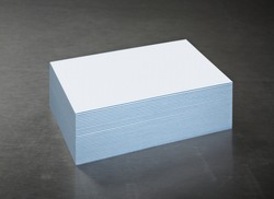 Business Cards Stack on Brushed Steel. Blank with Blue Striped edge.