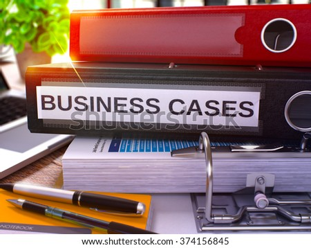Business Cases - Black Ring Binder on Office Desktop with Office Supplies and Modern Laptop. Business Cases Business Concept on Blurred Background. Business Cases - Toned Illustration. 3D Render.