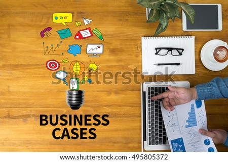 BUSINESS CASES Businessman working at office desk and using computer and objects, coffee, top view