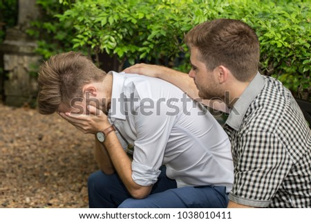 Business Caucasian man Stressed and Frustrated after work have problem and trouble in the garden and his friend soothe