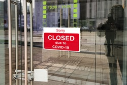 Business center closed due to COVID-19, sign with sorry in door. Stores, offices, other commercial buildings temporarily closed during coronavirus pandemic. Economy crisis and lockdown concept.