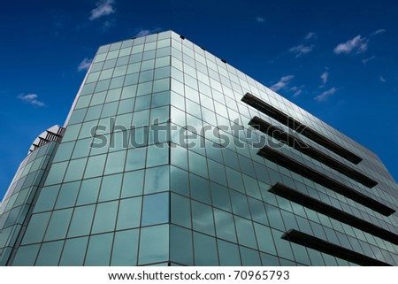 Business center from low angle with a blue dramatic sky