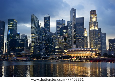 Business center of Singapore at night - stock photo