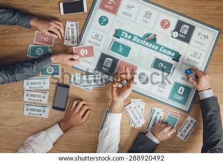 Business challenge board game and players at table rolling dices, hands close up, top view