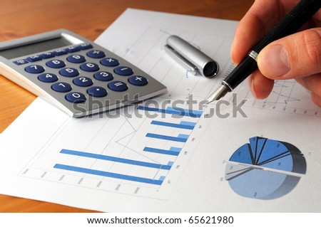 business chart graph or diagram and hand on desktop