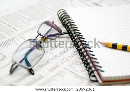 Business chart.Newspaper,pad and eyeglasses