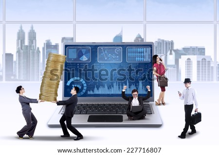 Business chart on laptop with busy entrepreneurs manage their business to increase profit