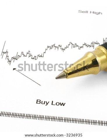 business chart with BUY LOW caption and ballpoint pen
