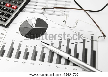 Business Charts Black and White with calculator, glasses and pen