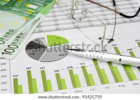 Business Charts Green with calculator with Euro Money, Glasses and pen - stock photo