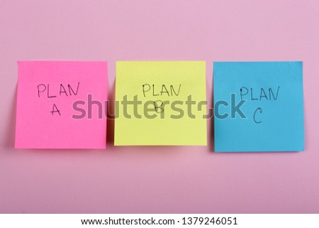 Business choice - Plan a, plan b or plan c on colorful office stickers on pink background