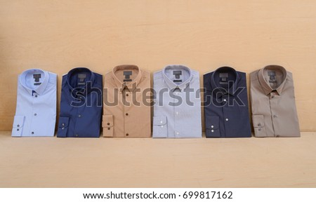 Business classic men\'s six, shirts on wooden background