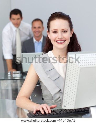 Business co-workers smiling at the camera in the office