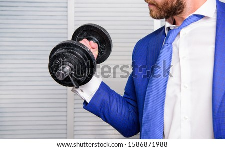 Business coach. Strong powerful business strategy. Efforts always rewarding. Put more effort. Man raise heavy dumbbell. Boss businessman manager raise hand with dumbbell close up. Successful business.