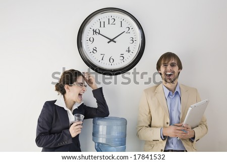 Business colleagues conversing at water cooler