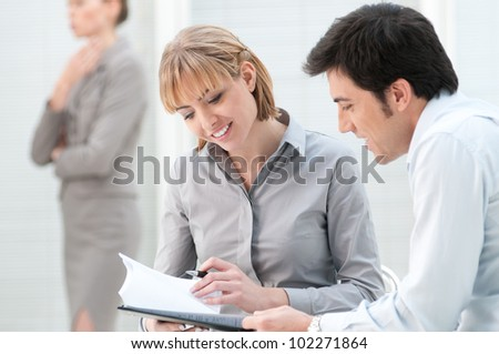 Business colleagues discussing on paperwork in a modern office