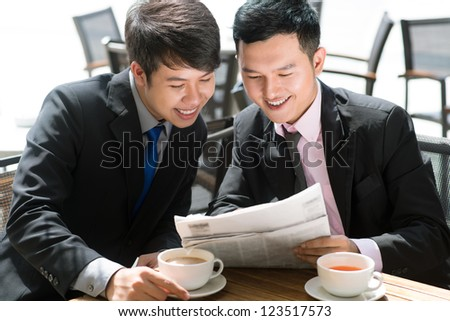 Business colleagues sharing good news