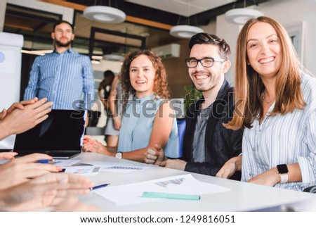 Business colleagues spend brainstorm sitting at a table in a modern office
