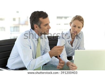 Business colleagues working on laptop
