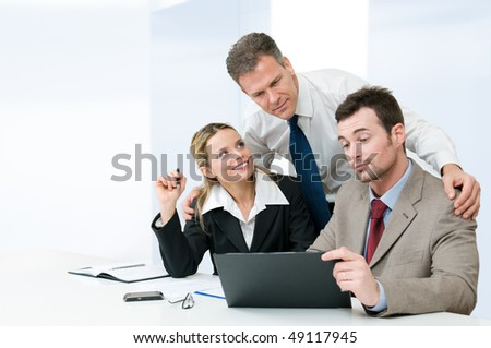 Business colleagues working together during a meeting with mature manager supervising the work