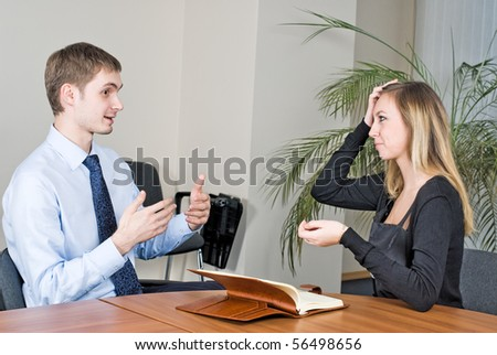 Business communication in office between businessman and businesswoman