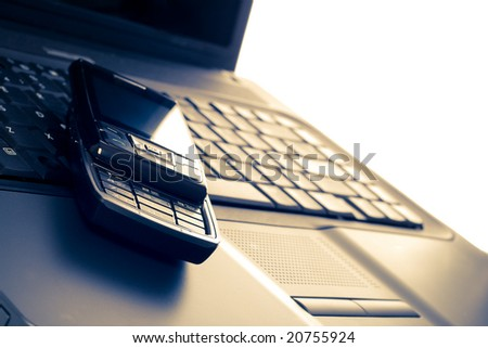 business communications, laptop and phone