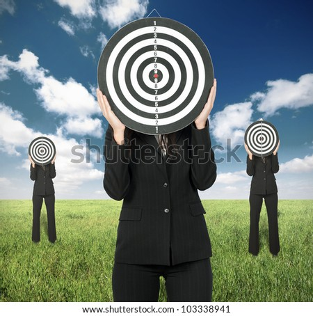 Business competition concept with businesswoman and darts board