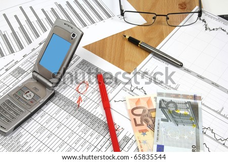 Business composition. Financial analysis - income statement, finance charts, red marker, Euro money and a mobile phone.