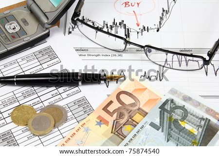 Business composition. Financial analysis - income statement, finance graphs, generic phone, Euro money and a fountain pen.