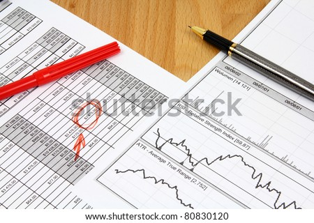 Business composition. Financial analysis - income statement, ink pen and red marker. - stock photo