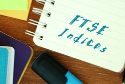 Business concept about Financial Times Stock Exchange FTSE Indices with inscription on the piece of paper.