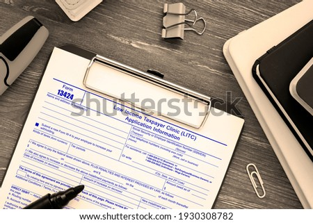 Business concept about Form 13424 Low Income Taxpayer Clinic (LITC) Application Information with inscription on the piece of paper. Stock photo ©