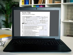 Business concept about  Form 730 Monthly Tax Return for Wagers   with sign on the piece of paper.
