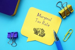 Business concept about Marginal Tax Rate with inscription on the sheet.