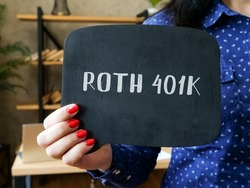 Business concept about ROTH 401K with sign on the piece of paper.