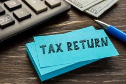 Business concept about TAX RETURN with phrase on the page.
