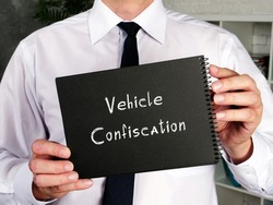 Business concept about Vehicle Confiscation with sign on the piece of paper.