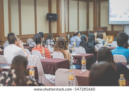 Business concept : asia people listen in business seminar presentation hall of hotel room,selective focus,vintage filter.