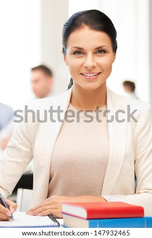 business concept - attractive businesswoman taking notes in office #147932465